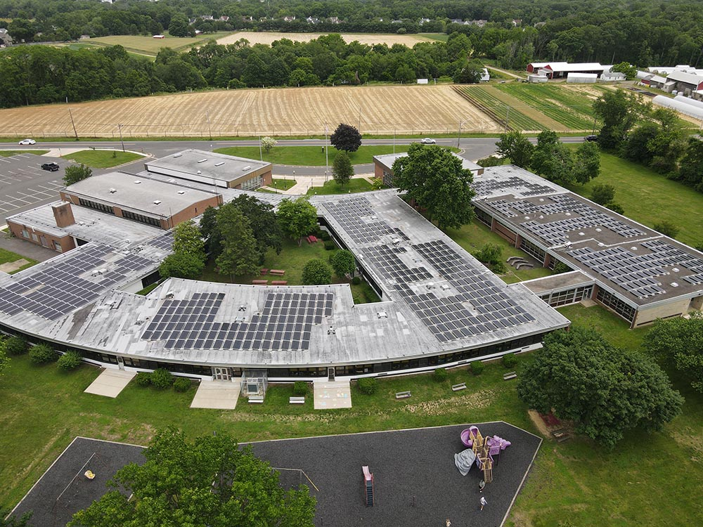 A photo of a solar array using a ballasted roof mount