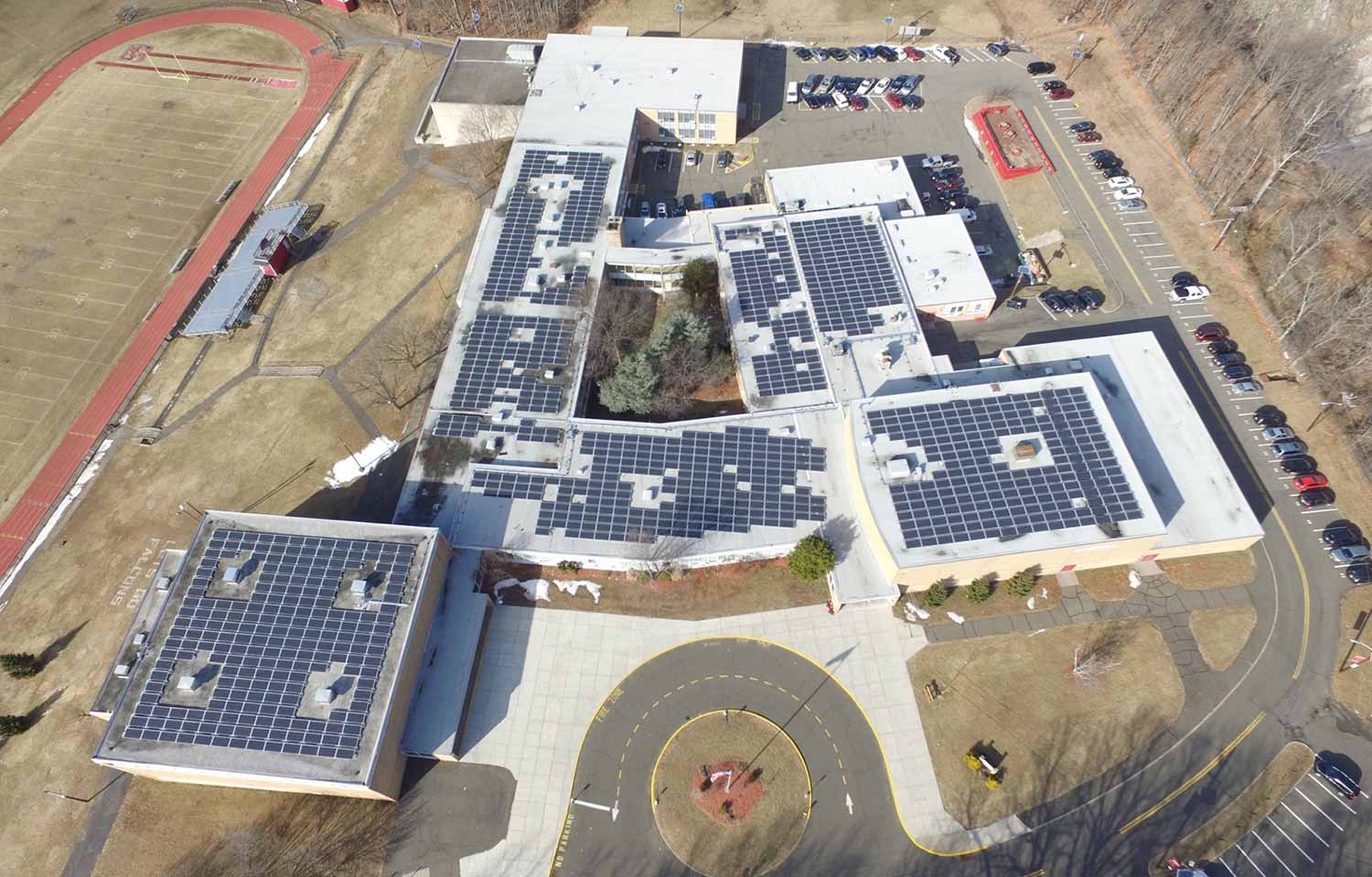 Manchester high school ballasted roof mount installation.