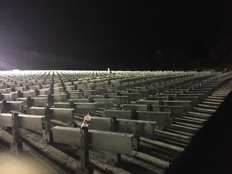 Field of steel racking assembled to concrete ballasts.