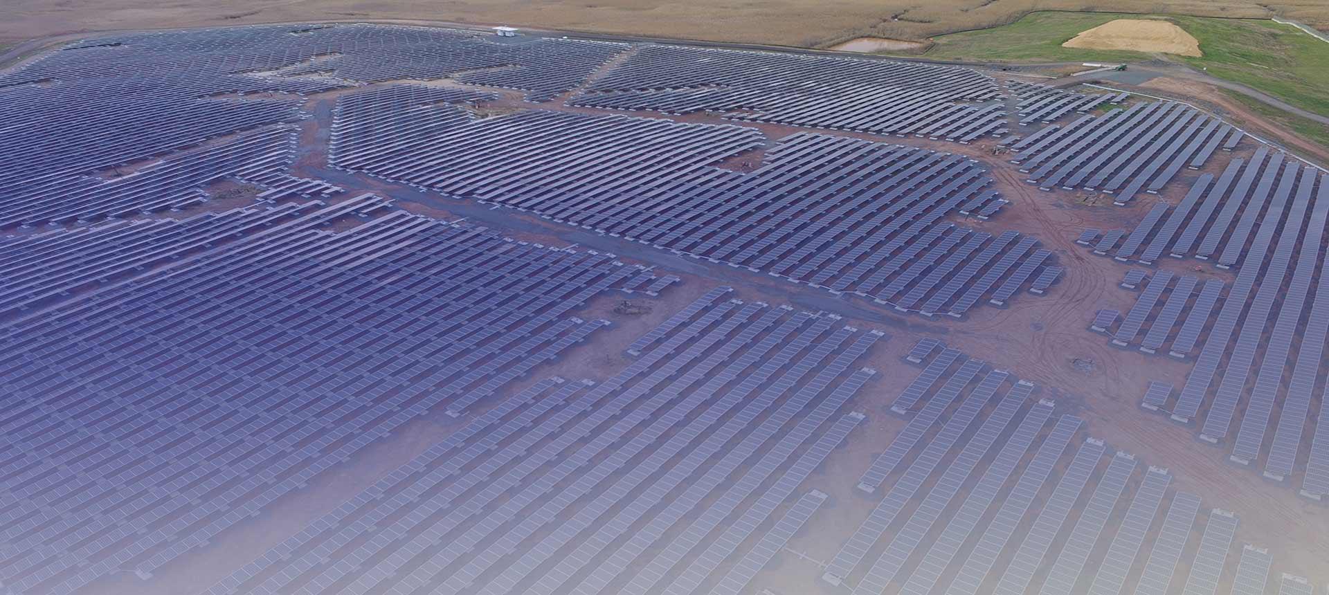 Photo of ballasted ground racking mounted solar panels on landfill